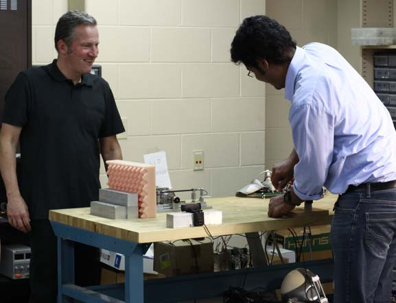Dr. Zinn, and student in the Robotics Lab